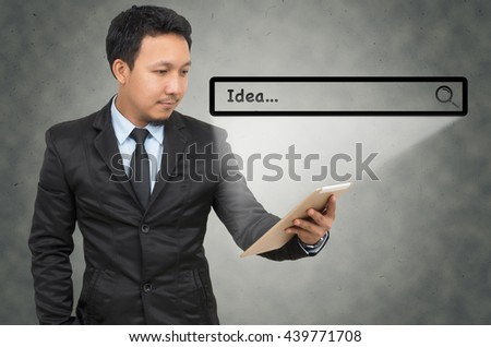 Asian businessman using the tablet with browsing of Internet searching bar on the wall background, Internet concept