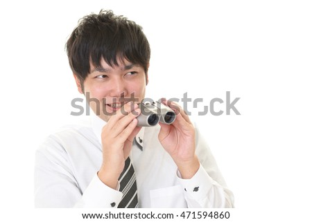 Asian businessman with a binoculars