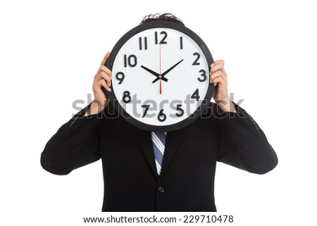 Asian businessman with a clock over face  isolated on white background