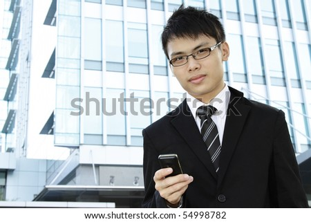Asian businessman with a handphone - stock photo