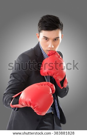 Asian businessman with boxing gloves, closeup portrait isolated. Concept about fight, struggle, against etc.