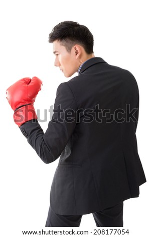Asian businessman with boxing gloves, closeup portrait isolated on white background. Concept about fight, struggle, against etc.