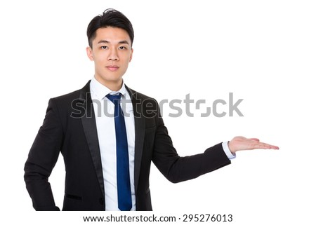 Asian businessman with hand showing something