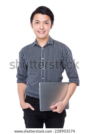 Asian businessman with laptop - stock photo
