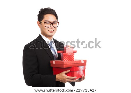 Asian businessman with many gift boxes  isolated on white background