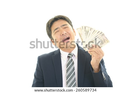 Asian businessman with paper money - stock photo