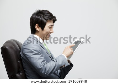 Asian businessman with tablet