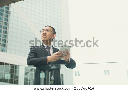 asian businessman with tablet computer on  hong kong central district
