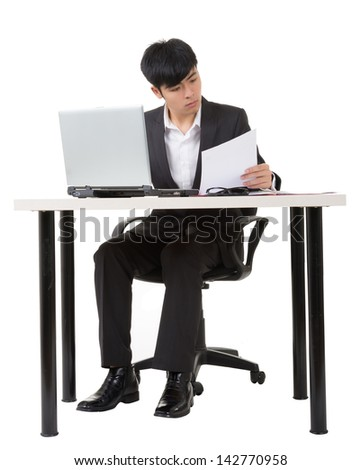 Asian businessman work, full length portrait with desk and chair on white background.