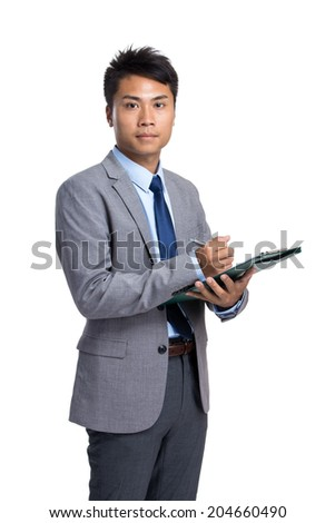 Asian businessman write on clipboard