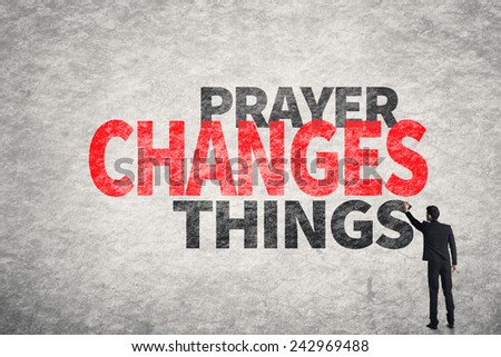 Asian businessman write text on wall, Prayer Changes Things - stock photo