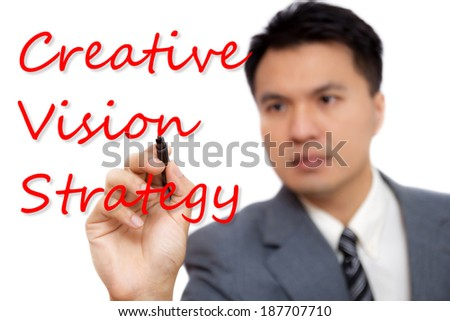 Asian businessman write the advertising strategy, isolated