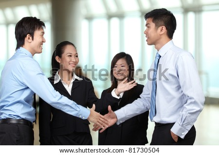 Asian Businessmen shaking hands - stock photo