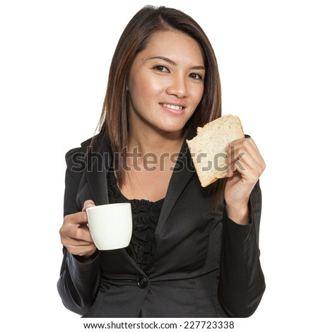 Asian businesswoman attractive young pretty brunette drinking coffee and breakfast smiling on a white background - stock photo