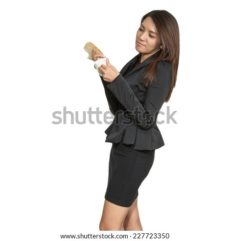 Asian businesswoman attractive young pretty brunette drinking coffee and breakfast smiling on a white back gourd - stock photo