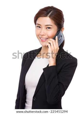 Asian businesswoman chat on cellphone - stock photo