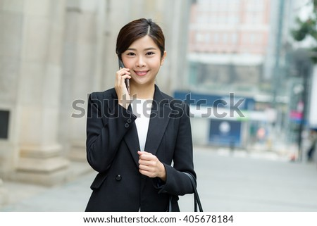 Asian Businesswoman chat on mobile phone at outdoor