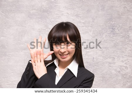 asian businesswoman counting nine - stock photo