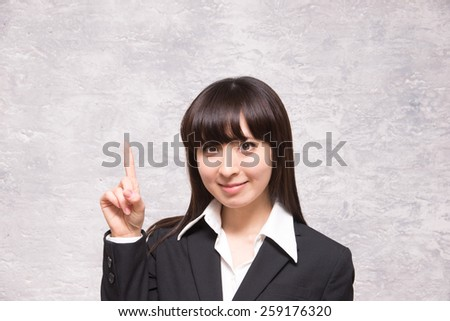 asian businesswoman counting one - stock photo
