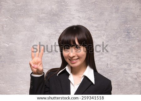 asian businesswoman counting three - stock photo