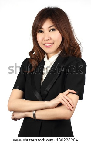 Asian businesswoman folding arms and smiling