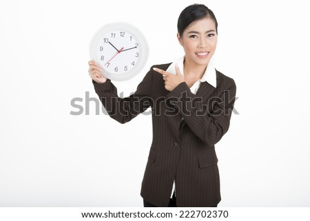 Asian businesswoman hold a clock isolated on white background