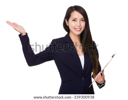 Asian Businesswoman hold with file board and hand showing blank sign