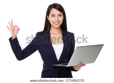 Asian businesswoman hold with laptop computer and ok sign - stock photo