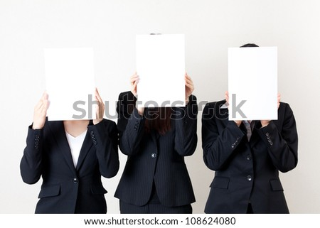 asian businesswoman holding a blank whiteboard