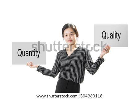 Asian Businesswoman holds signs letters, Given the choice between Quantity or Quality