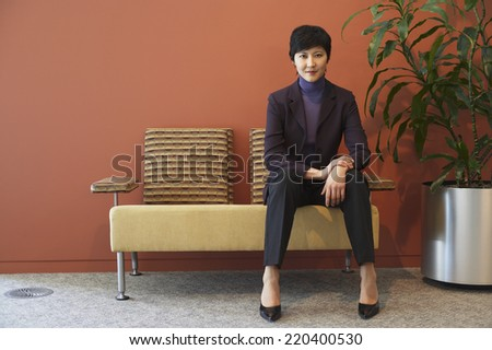 Asian businesswoman in waiting area