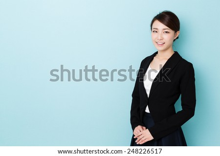 asian businesswoman isolated on blue background