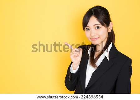 asian businesswoman isolated on yellow background - stock photo