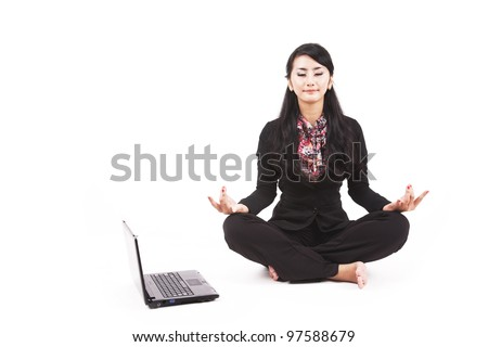 Asian businesswoman meditating shot in studio isolated on white
