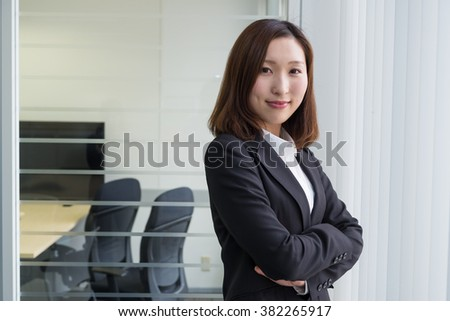asian businesswoman near the windows