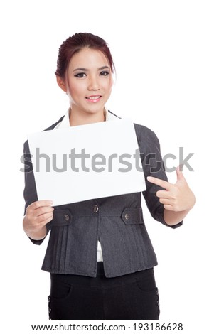 Asian businesswoman point to  a blank sign and smile isolated on white background