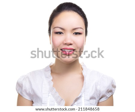 Asian businesswoman portrait. Casual portrait of beautiful confident multi-ethnic Asian Chinese / Caucasian female businessperson smiling isolated on white background in studio. Young professional. - stock photo
