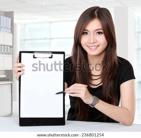 asian businesswoman presenting blank document in the office - stock photo