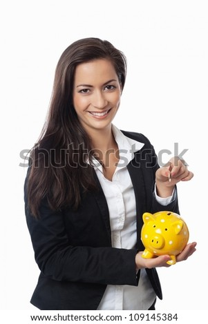 Asian Businesswoman putting money into piggy bank isolated on white - stock photo