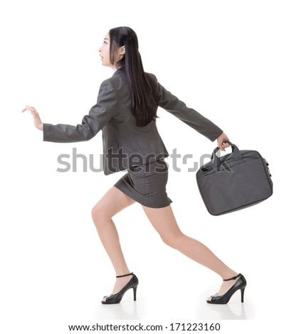 Asian businesswoman run and hold a briefcase, side view full length portrait isolated on white background. - stock photo