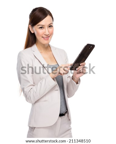 Asian businesswoman touch on digital tablet