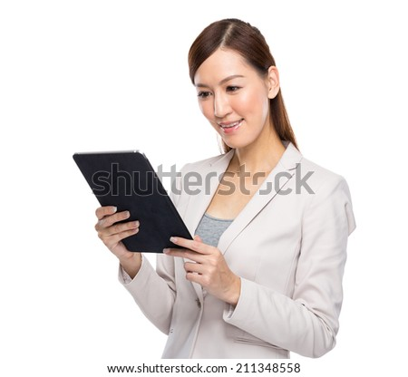 Asian businesswoman use digital tablet