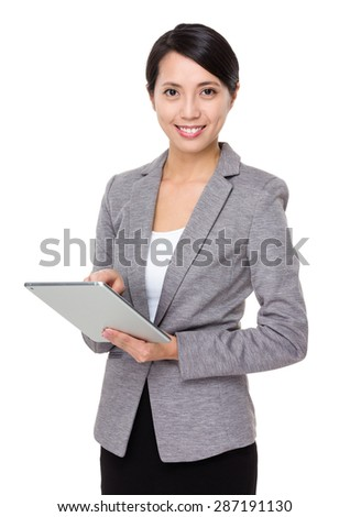 Asian businesswoman use of digital tablet - stock photo