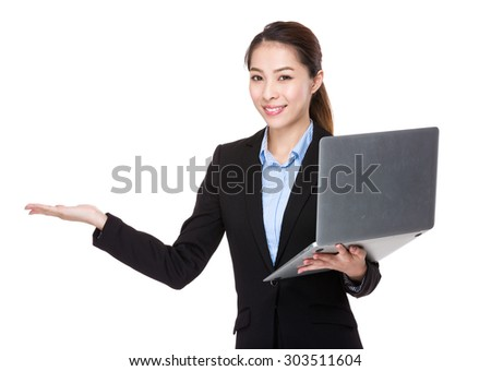 Asian businesswoman use of the notebook computer and open hand palm for showing something