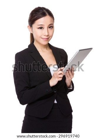 Asian businesswoman use of the tablet pc