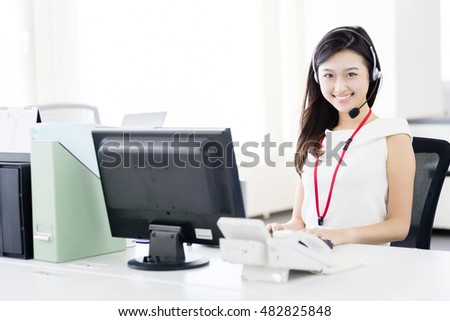 asian businesswoman using headset in the office