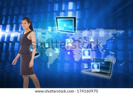 Asian businesswoman walking against glowing squares on blue background