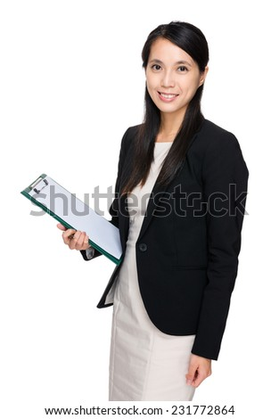 Asian businesswoman with clipboard - stock photo