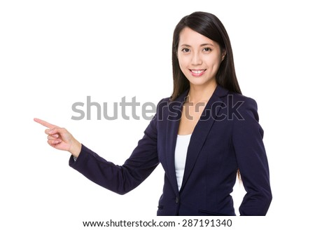 Asian businesswoman with finger showing up - stock photo