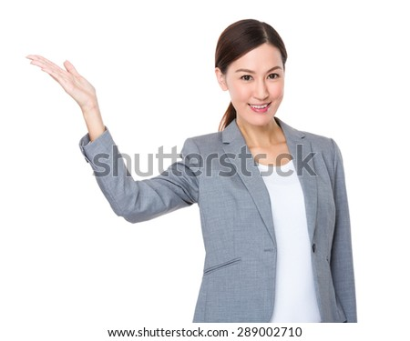 Asian businesswoman with hand show with blank sign